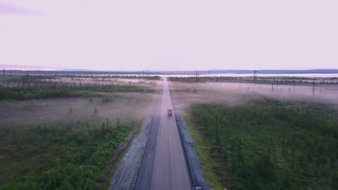 Northern Russian road in summer in the forests, aerial shot Footage