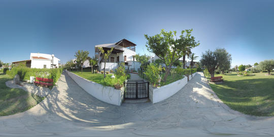360 VR Green resort area with cottages in Trikorfo Beach resort, Greece Live Action
