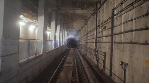 Subway train running through the tunnel. Train traveling through the underground Live Action