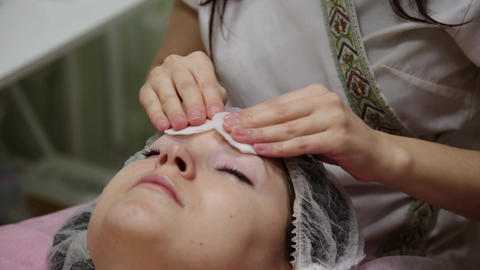 Very beautiful girl wipes her face with napkins before massaging her face in the Footage
