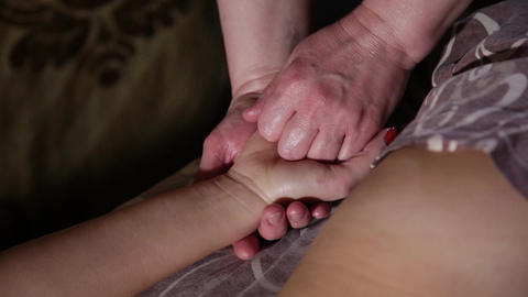 Very beautiful girl gets a massage on the hand in the spa salon Footage