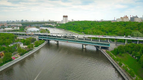 MOSCOW, RUSSIA - MAY, 24, 2017. Aerial shot of Moscow river tour boats, cars and Live Action