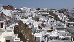 Greece Aegean Sea Cyclades Santorini white houses of Oia at hillside ビデオ