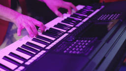 Close up of men hands playing on piano. Male hands playing piano view from above Live Action