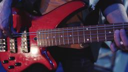 Man playing electrical bass guitar. Bass Guitar closeup Footage