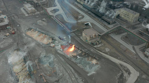 Pour molten slag from the diesel locomotive tank at a metallurgical plant Live Action