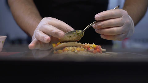 The chief cook decorates a dish of high cuisine. Fish dish Live Action