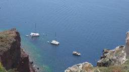 Greece Aegean Sea Cyclades Santorini sailing boats at anchor deep below town ビデオ