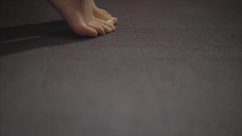 Beautiful women's feet. Beautiful legs on the gray floor Stock Video Footage