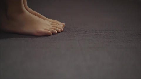 Beautiful women's feet. Beautiful legs on the gray floor Footage