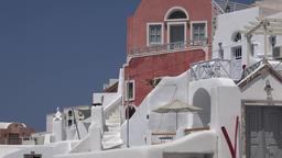 Greece Aegean Sea Cyclades Santorini white and purple apartment flats in Oia ビデオ