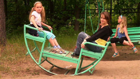 Mother with a daughter on the swing Stock Video Footage