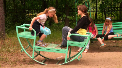 Mother with a daughter on the swing Footage