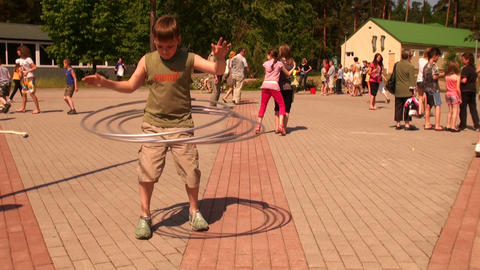 The child turns hoops Stock Video Footage