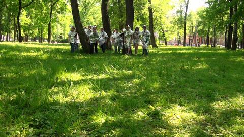 Running on the grass, children Stock Video Footage