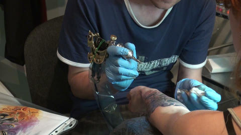 Tattooing on the body Stock Video Footage