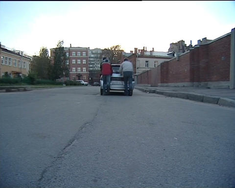 Men pushing a car Stock Video Footage