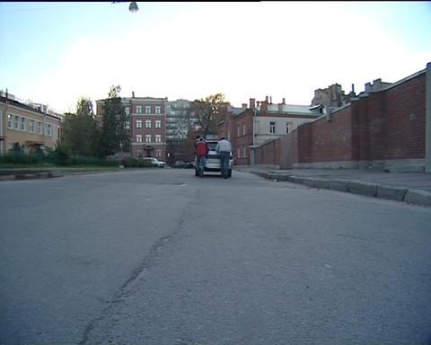 Men pushing a car Footage