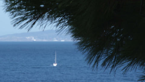 Far shot of a boat on the water in Punta Ala Italy Footage