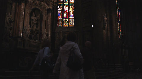 Stained glass inside a church in Milan Italy Live Action