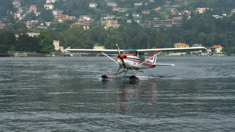 Shot of an airplane skimming across Lake Como in Italy Footage