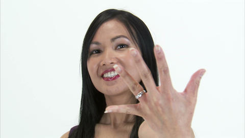 Clip of a woman showing off her diamond engagement ring Live Action
