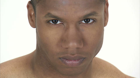 Close up of a man's face looking up and staring intently Footage
