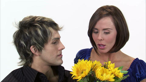 Man gives a woman sunflowers then they kiss Footage
