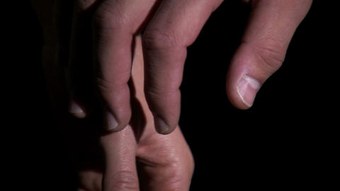 Close-up of hands being held with a black background Footage