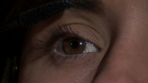 Close up of an eye as mascara is applied Footage