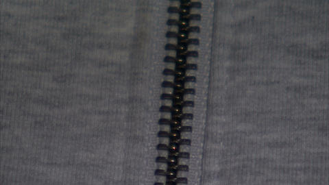 Close up of a sweater zipper going up then down Footage