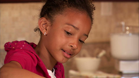 Girl placing cookies on a plate Footage