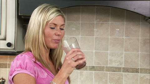 Woman drinking a fruit shake Footage