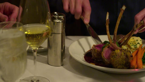 Right to left panning of hands at a table place setting Footage