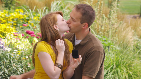 Man proposes to a woman in a beautiful garden Live Action
