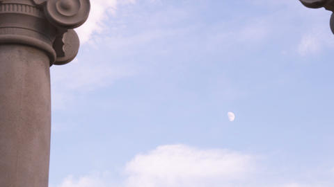 Small day moon between two ionic pillars Footage