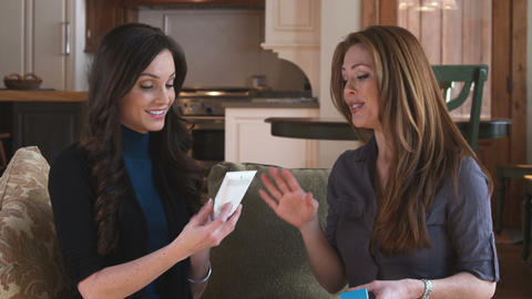 Two women discussing a cosmetic product Footage