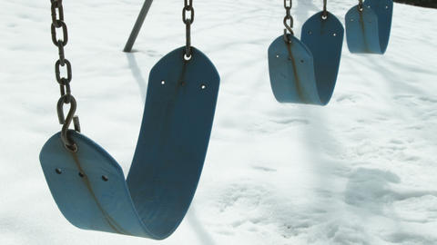 Empty swings against the snow Footage