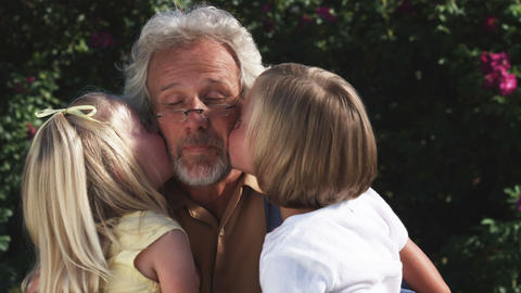 Clip of granddaughters kissing their grandfather Live Action