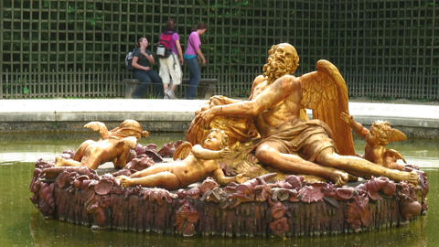 Close up of golden statues in a Versailles pond in France Live Action