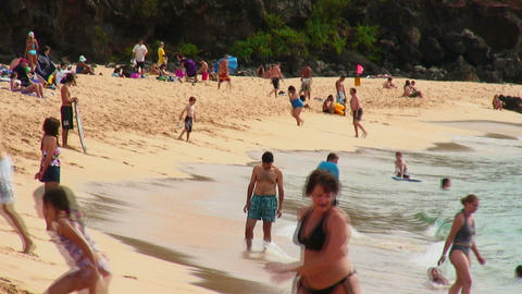 Families and friends playing in the surf on a sandy Hawaiian beach Footage