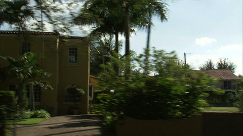 Drive by view of a Miami residential area Live Action