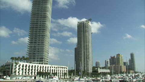 Pan from hotels to a boat marina in Miami Live Action