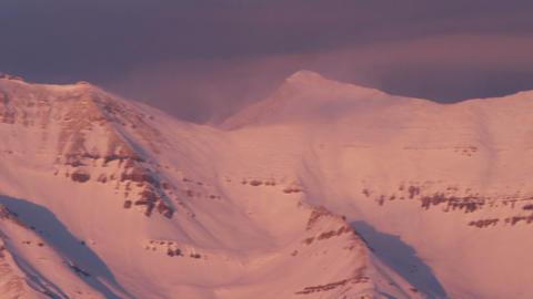 Pan of snowy mountain summit Footage