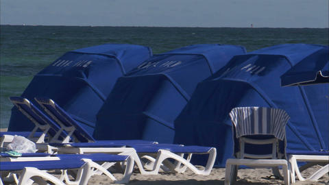 Beach canopies in Miami on a windy day Footage