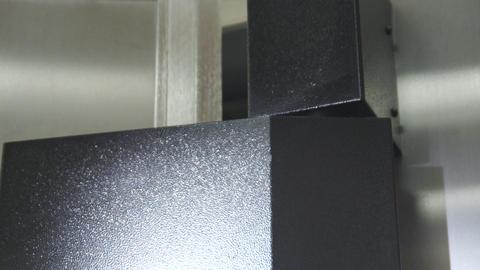 Close-up shot of a safe hinge opening Live Action
