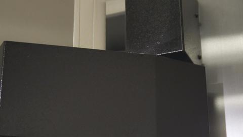 Close-up shot of a safe hinge shutting Live Action