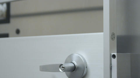Close-up shot of door with safe opening and shutting the the background Live Action