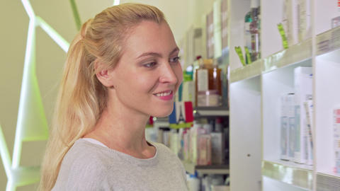Lovely young woman smiling to the camera, shopping at... Stock Video Footage