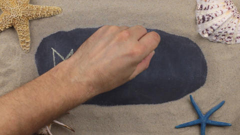 Handwritten word MEXICO written in chalk, among seashells and stars. Top view Footage